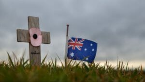 Image of An Australian flag and remembrance cross sits at the Australian National Memorial, Villers-Bretonneux, France.