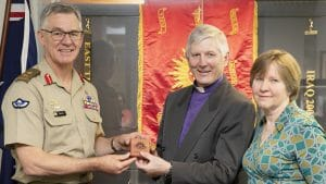 Image of Chief of Army, Lieutenant General Rick Burr, AO, DSC, MVO, presents a Federation Star to Bishop Grant Dibden alongside his wife Janet at Russell Offices, Canberra.