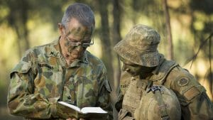 Image of Australian Army padre Chaplain John Saunders (left) provides spiritual guidance to a soldier at Lone Pine Barracks, Singleton, NSW, on 27 April 2016.