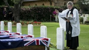 Image of Australian Army padre Chaplain Jim Cosgrove reads a prayer during the reinternment service held at Sydney War Cemetery in Rookwood, NSW, on Friday, 3 June 2016.