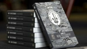 Image of brand new copies of the Royal Australian Navy's DPNU Bible sit ready for distribution, onboard HMAS Canberra