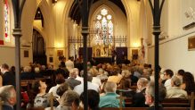 Image of Naval personnel, visiting dignitaries and members of the local community gathered in St. John's Anglican Church for a commemorative service for the loss of HMAS Perth