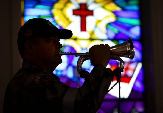Image of Petty Officer Musician Nigel Barrett plays the Last Post during a commemoration of the 23rd anniversary of the fire aboard HMAS Westralia (II) in the chapel at HMAS Stirling, Western Australia.